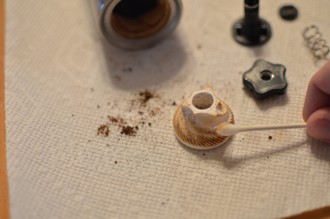 Cleaning manual coffee grinder burrs
