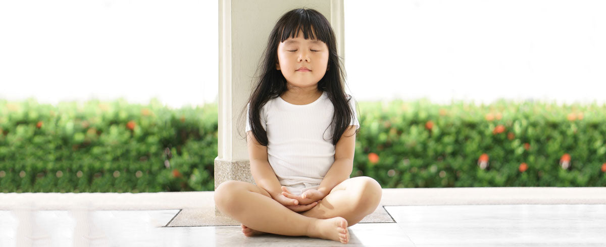 Girl meditating, from mindful.org
