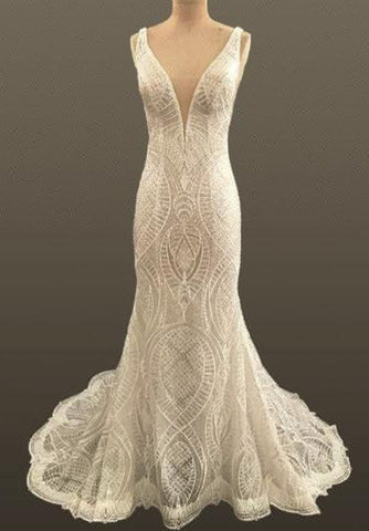 Lace wedding dress with plunging neckline and opened back backless