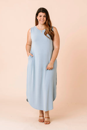 colorblock sweater that has a mock neck, long balloon sleeves with fitted cuffs and a relaxed bodice.