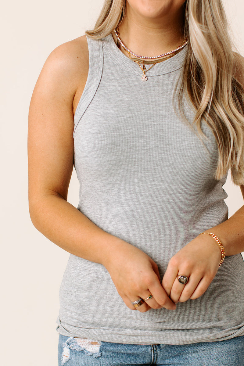 faux fur jacket that has long sleeves, large lapels, and a zipper closure on the front.