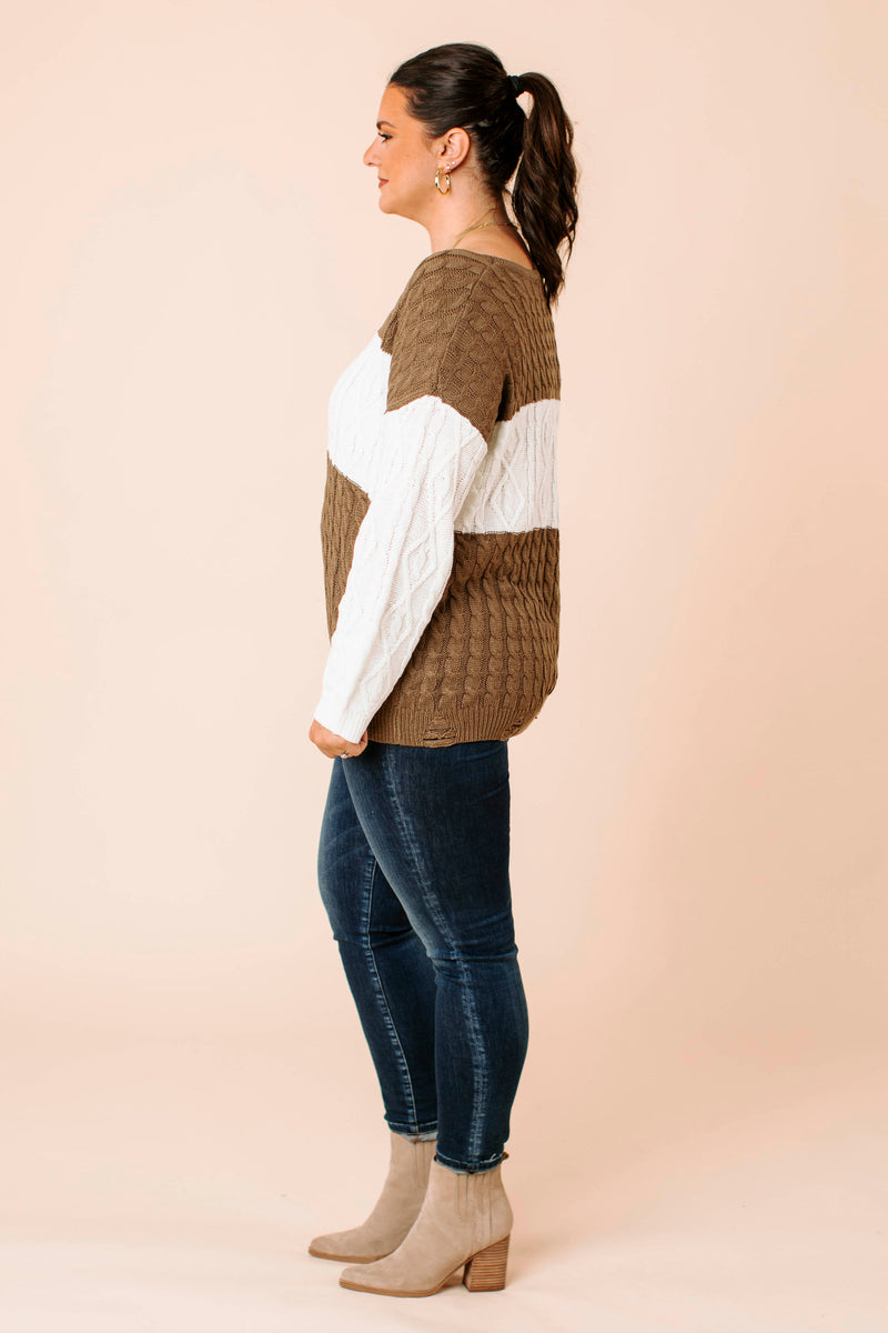 basic knitted, short sleeved tee that features round neckline and relaxed bodice with round hem and back center seam.