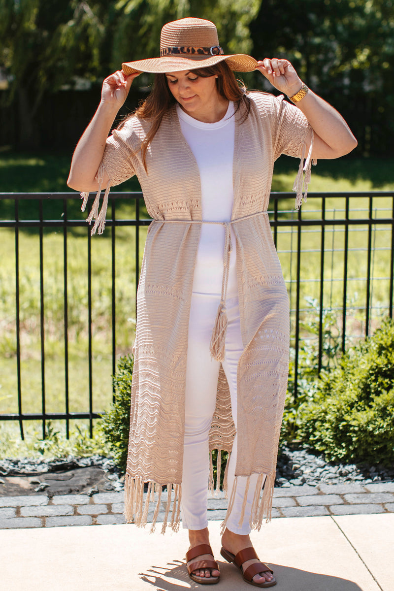 oversized faux fur jacket that has long sleeves, button closure with collar and pockets