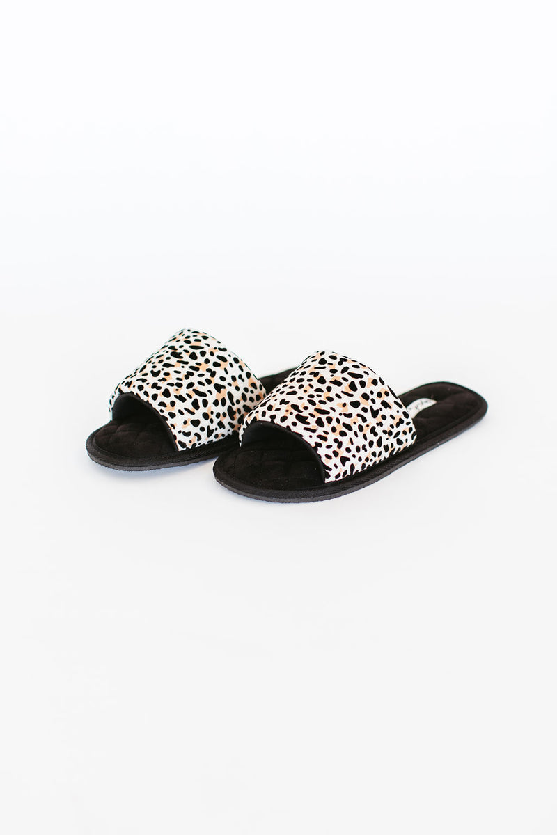 Slippers are slippers that feature a quilted sole along with thick leopard band across the arch with peep toe.