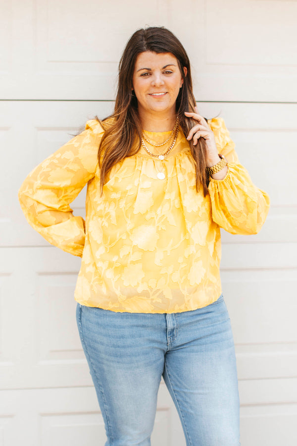 Slides are slip on sandals that feature two rhinestone straps across the arch.