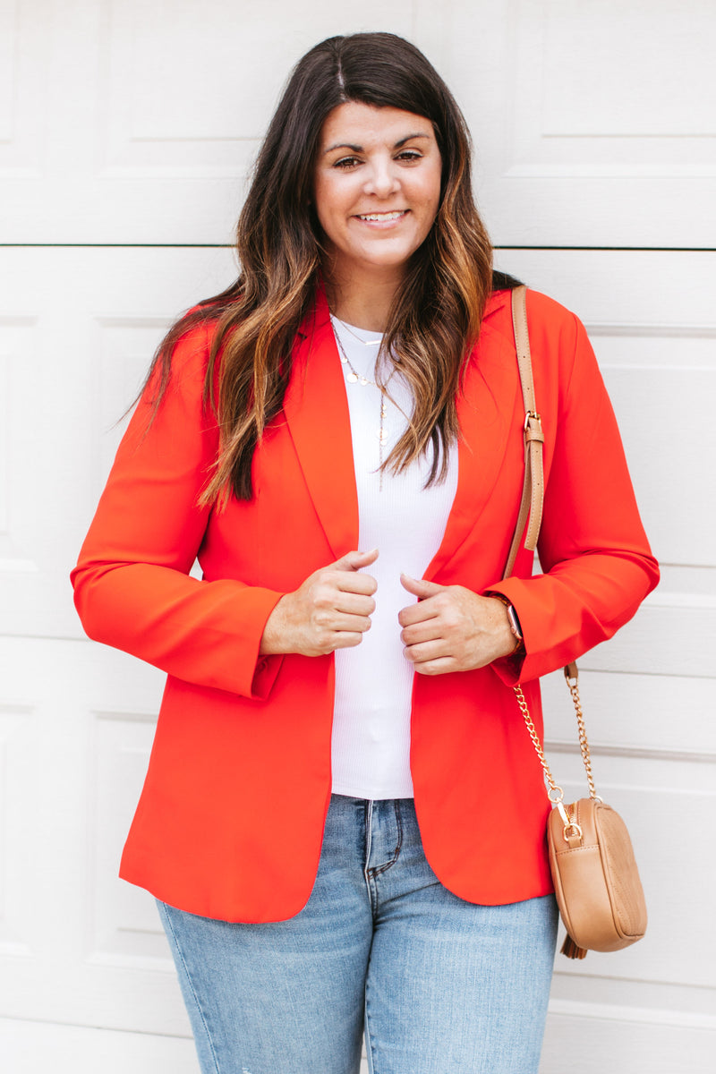 oversized fitting sweatshirt that has a large front pocket, hood, and contrasting drawstrings.