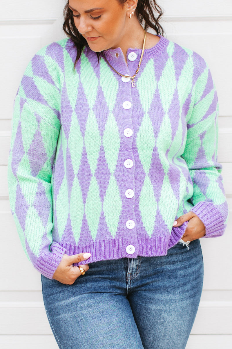 an oversized lounge set that features a long sleeved top with a crew neckline with matching lounge pants with elastic, drawstring waist.
