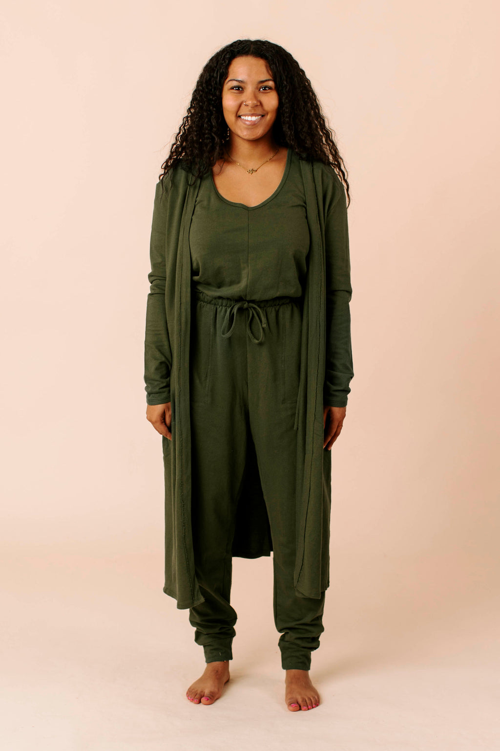 longer, quilted jacket that features light padding, long sleeves, button closure and lapels.