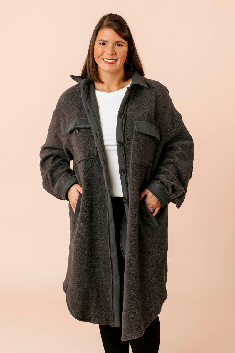flannel plaid shirt jacket, shacket that features long sleeves, breast pockets and collar.