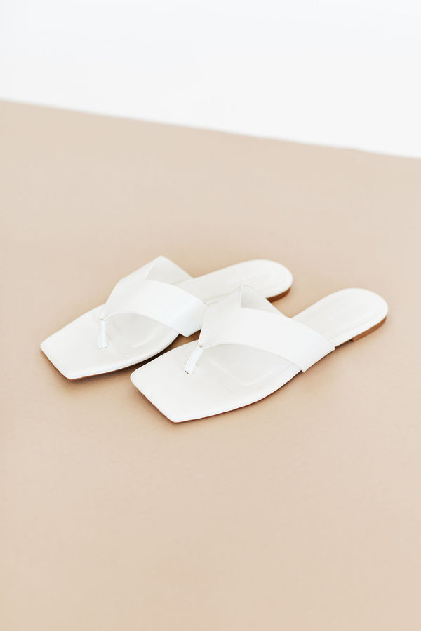 Sandals are flat, thong sandals that features two thick straps that fit comfortable over the arch with a square toe.