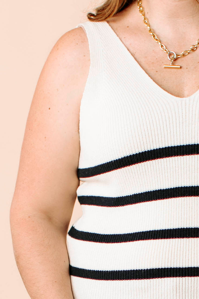 waffle cardigan sweater that has long sleeves, front pockets, and open closure with a relaxed fit.