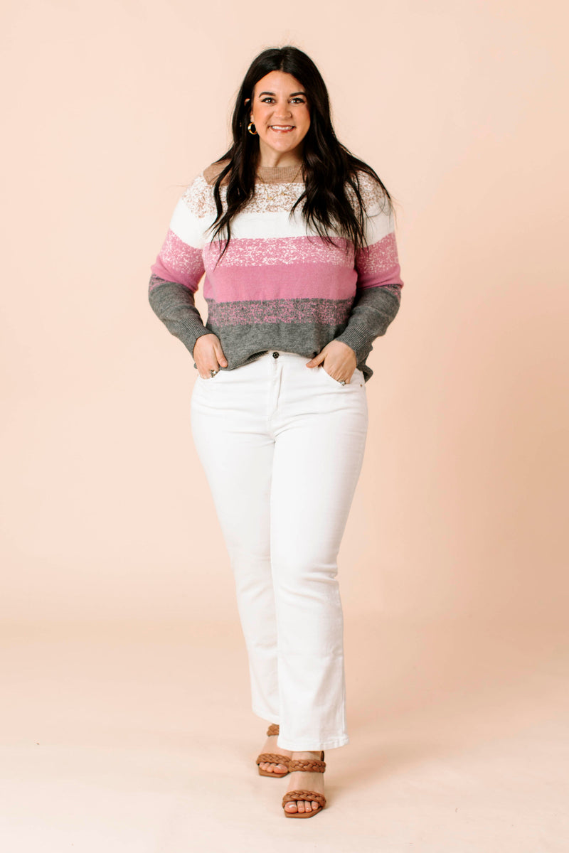 long sleeved, plaid jacket that features a collared neckline, two flap pockets, dropped shoulder and relaxed bodice with rounded hem.