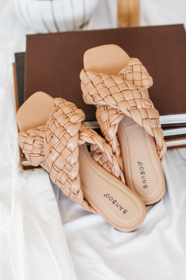 Criss Cross Slides have two braided straps that criss cross in the center with a peep toe and an easy on and off.