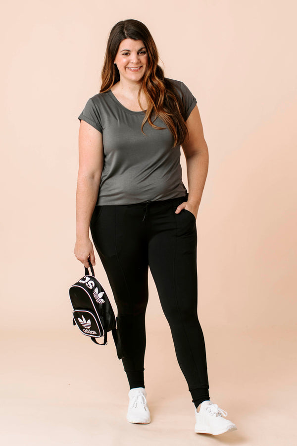Messenger Bag is a faux leather messenger bag that features a front pocket and large pocket with one compartment and a zipper pocket magnetic closure.