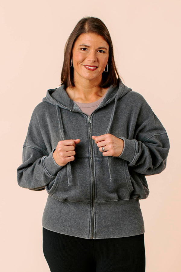 Tote is a solid colored tote bag that has slim handles, and one large compartment with a magnetic closure and a detachable pouch.