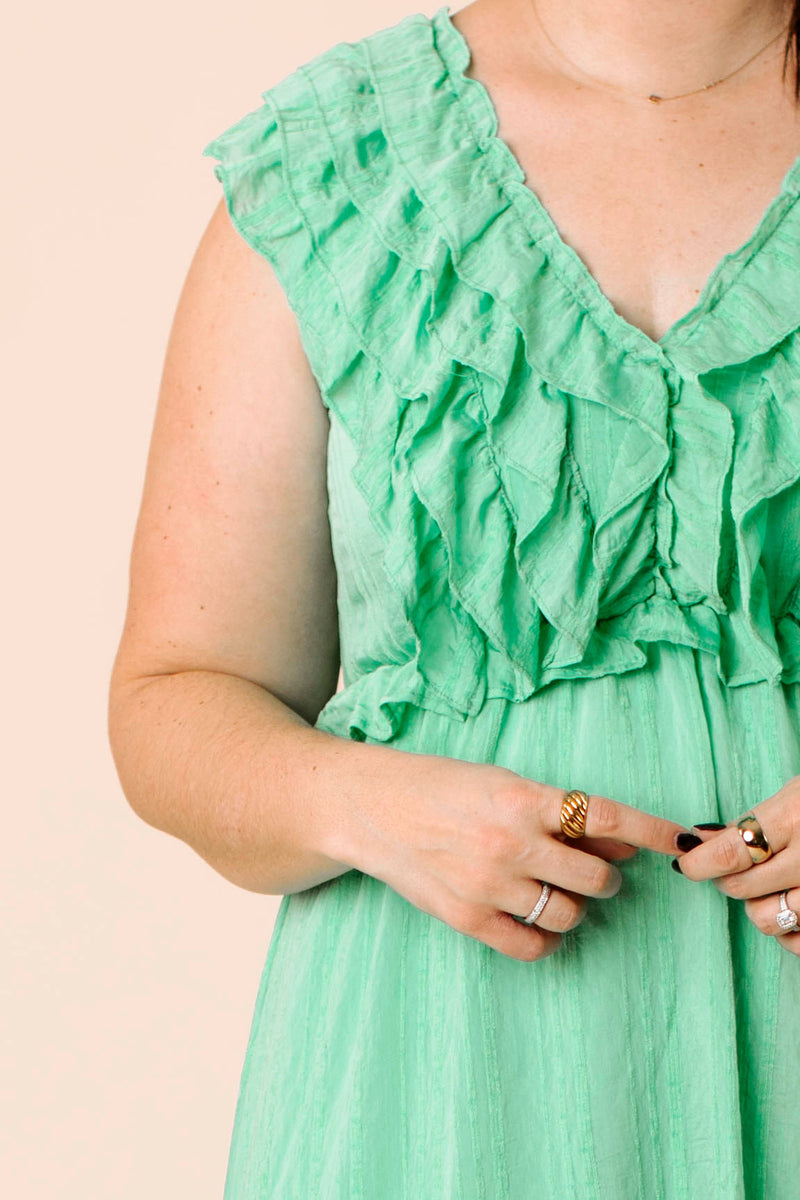 thick checker plaid jacket that features long sleeves, button down closure and collar.