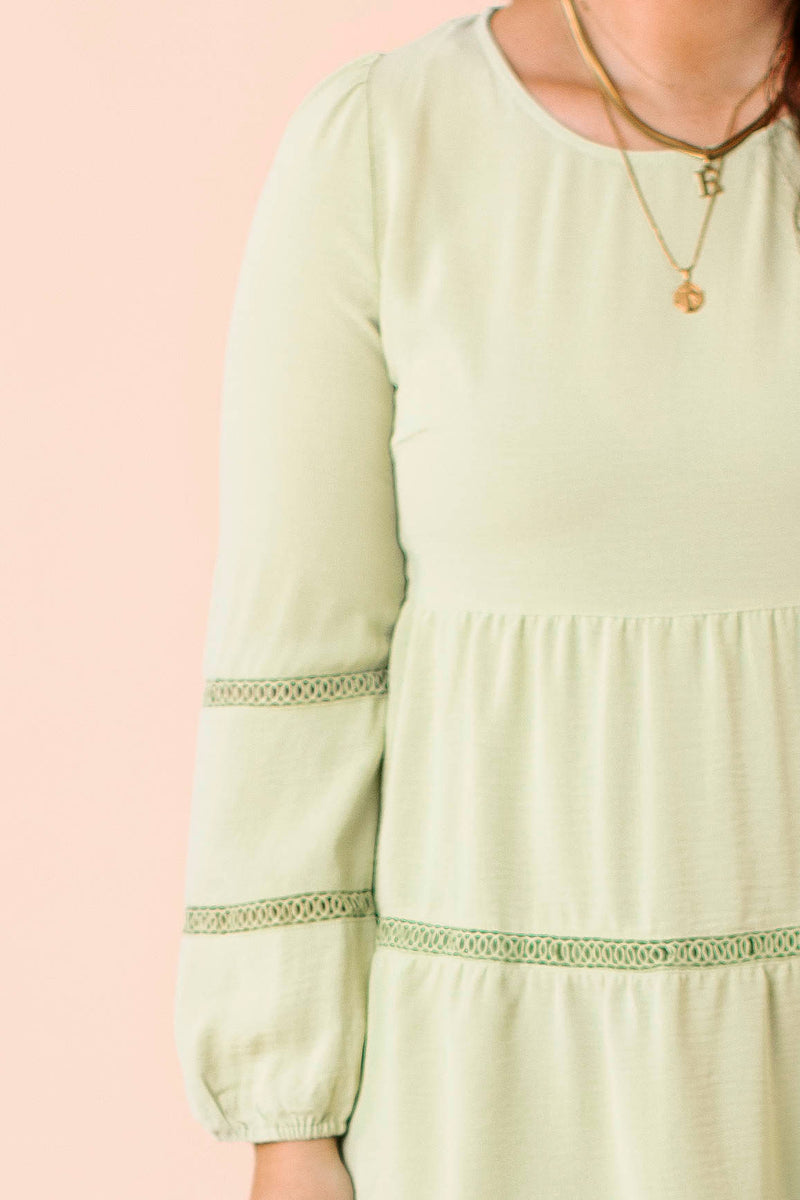 midi length, chenille cardigan that features a striped pattern throughout, long sleeves, and side pockets.