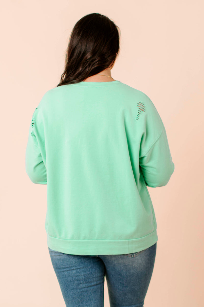 textured knit sweater that features a round neckline, balloon long sleeves, and ribbed hemline