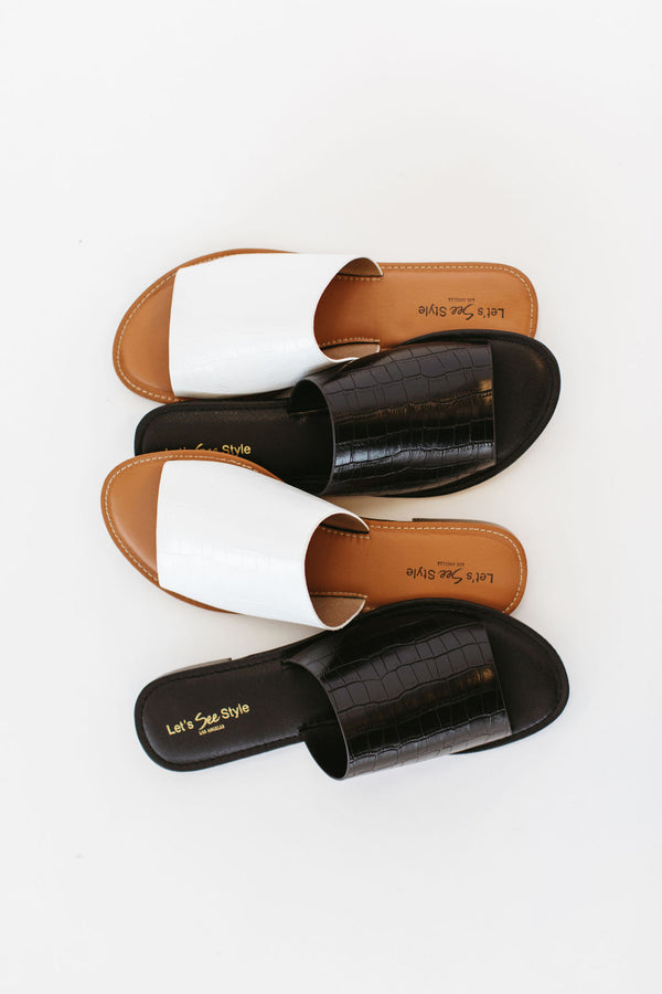 Sandals are open toed, faux crocodile textured sandals with an easy slip on along with cozy fit.