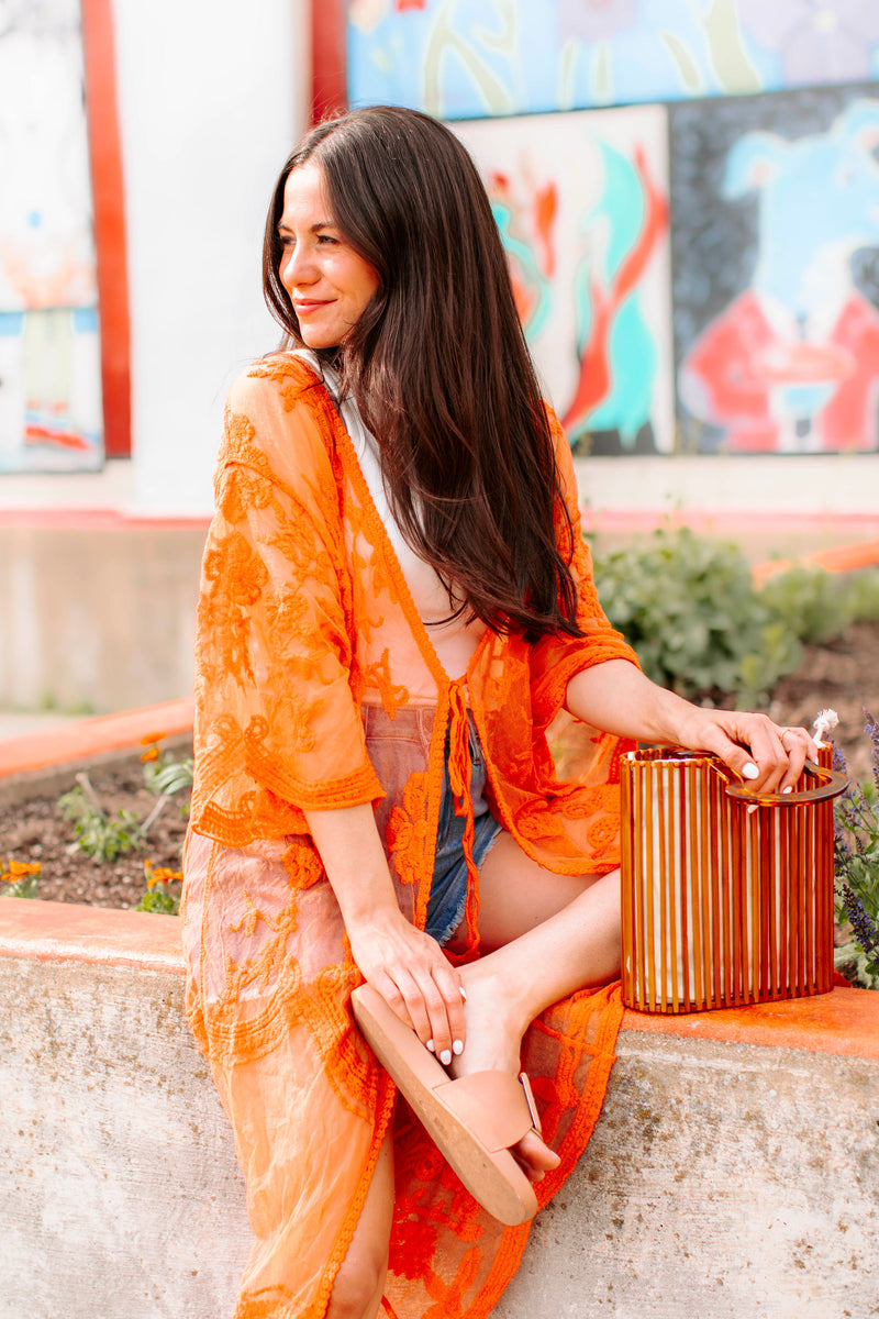 Curve Tee is a cuffed, short sleeved tee with a v neckline, and rounded bottom hem and relaxed fit.