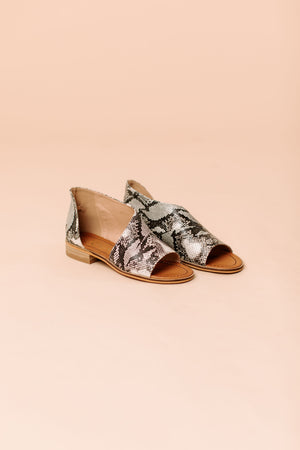 faux leather cut out slip ons that feature a peep toe and easy slide on and off.