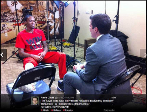 "Kevin Ware wearing the Smack Apparel ""Win it for Kevin"" shirt during a TV interview"