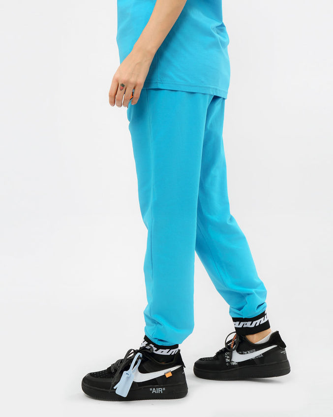 WOMEN CORE 3D RUBBER PATCH JOGGERS-COLOR: BLUE