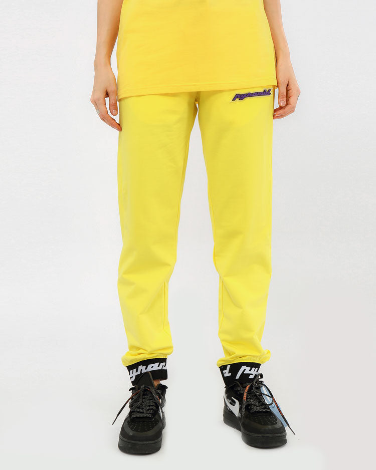 WOMEN CORE 3D RUBBER PATCH JOGGERS-COLOR: YELLOW