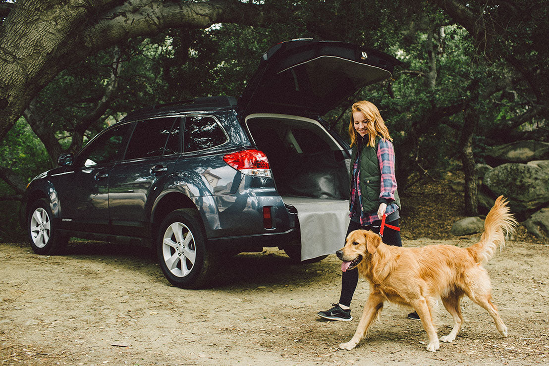Woman With Dog In Subaru Outback with Cargo Liner