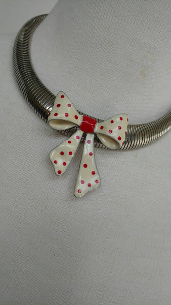 polka dot bow on a silver chain necklace