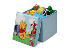 Delta Children Winnie the Pooh Collapsible Storage Ottoman, Left View with Props Style 1 a2a