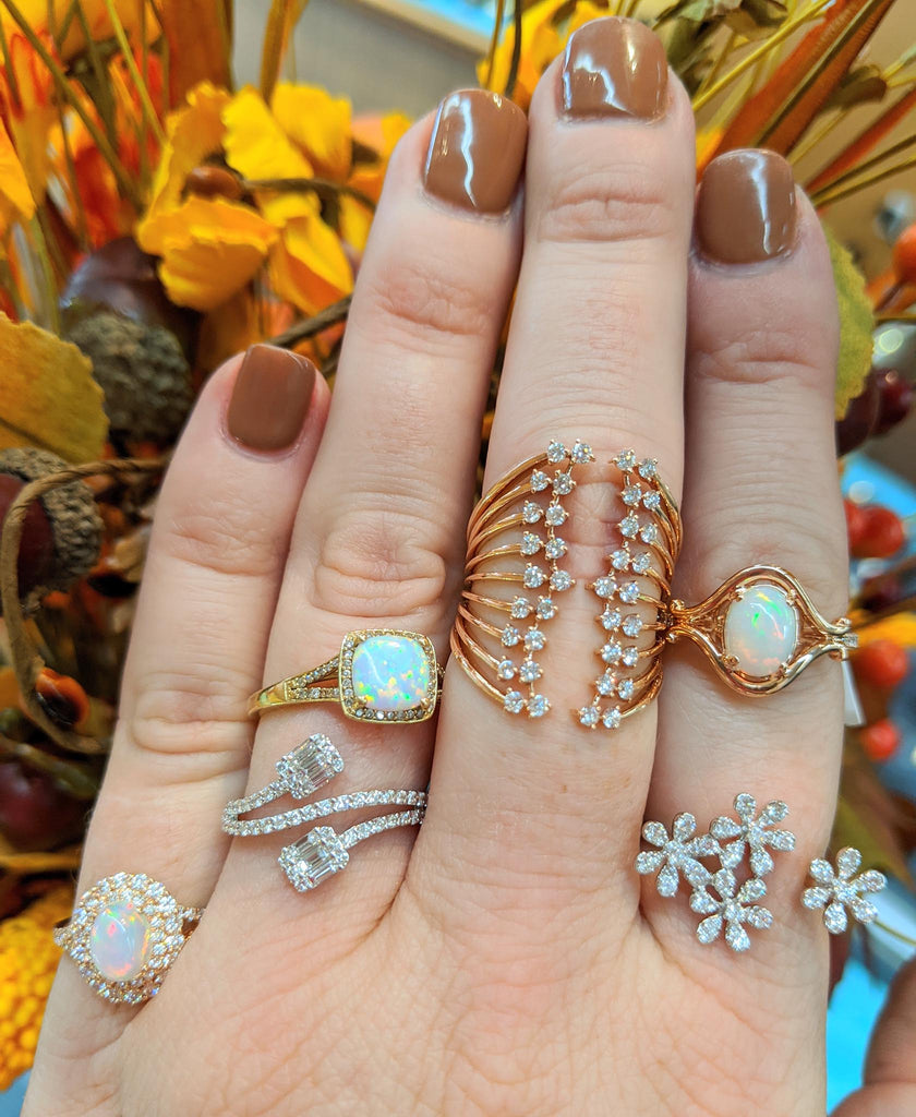 Hand with gold and gemstone rings.