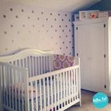 Gold polka dot wall decals for nurseries.