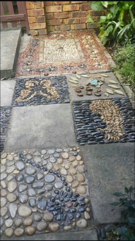 Granite tiles and pebble mosaic walkway