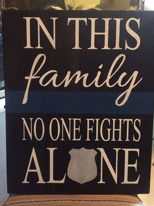 In this family no one fights alone-police badge in alone