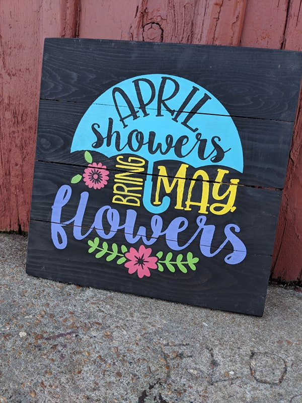 April Showers bring may flowers with umbrella
