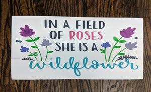 In a field of roses she is a wildflower