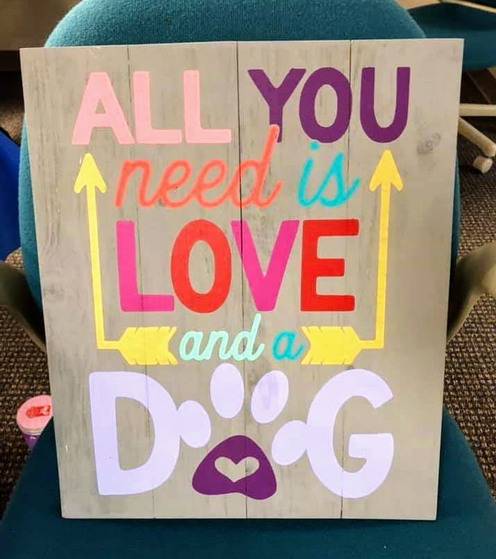 All you need is love and a dog with arrows and pawprint