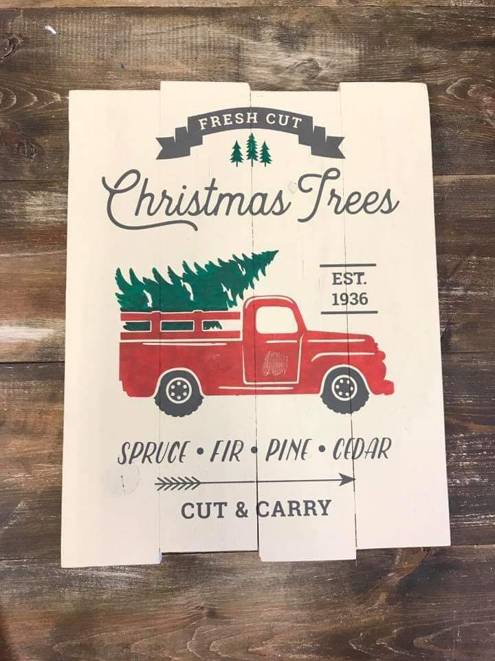 Fresh cut Christmas trees with truck
