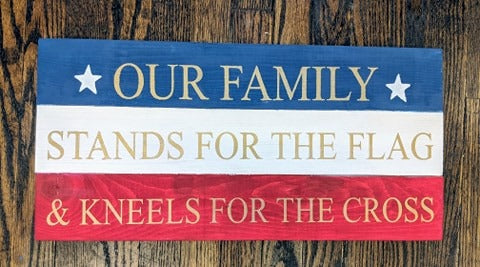 Our family stands for the flag and kneels for the cross