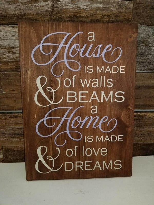 A house is made up of walls and beams a home is made of love and dreams