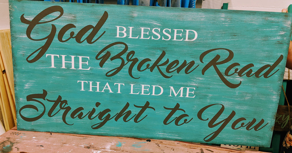 Oversized sign - God Blessed the Broken Road