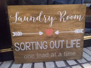Laundry room sorting out life one load at a time with arrows