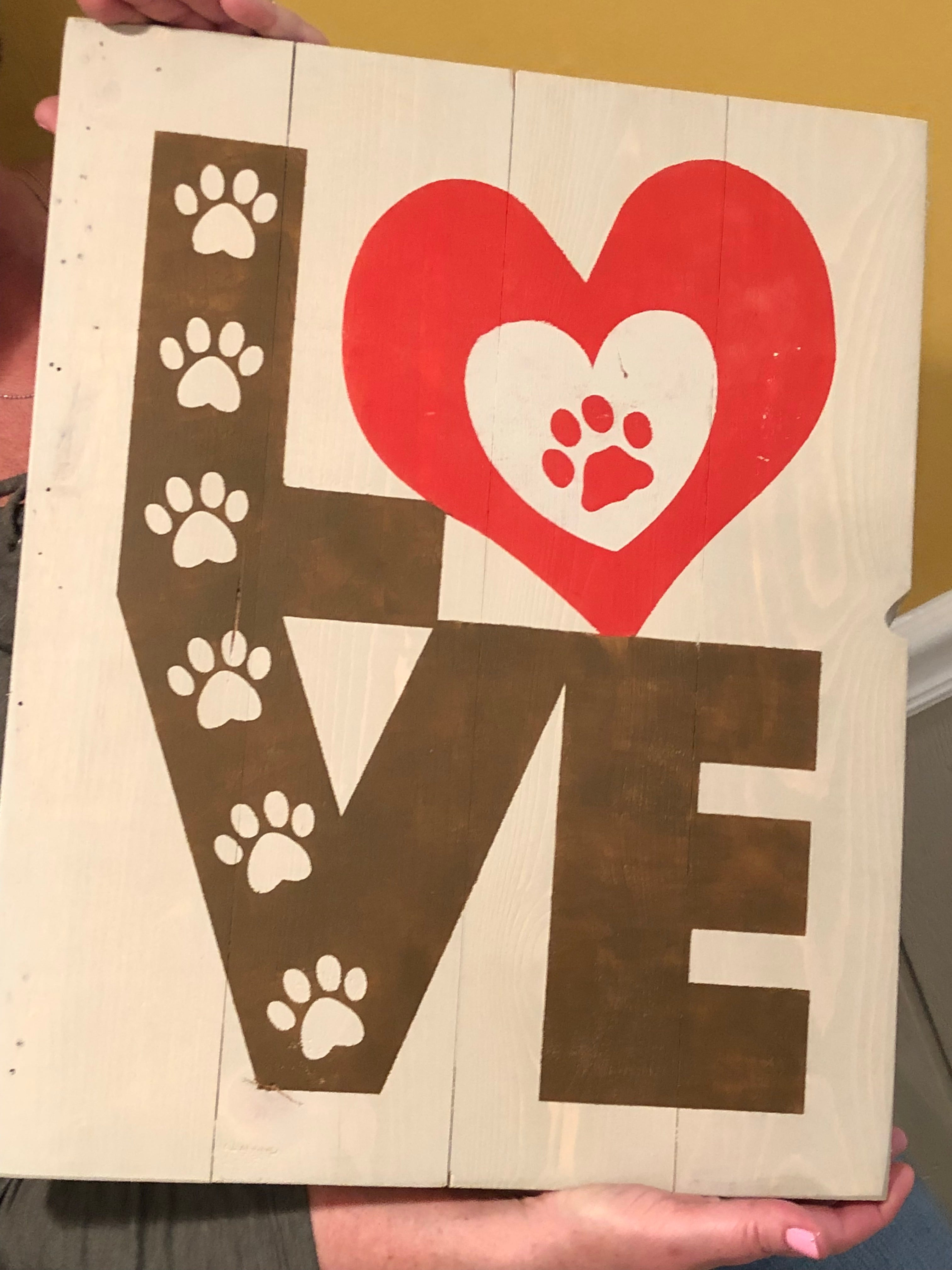 Love with paw prints in the letters