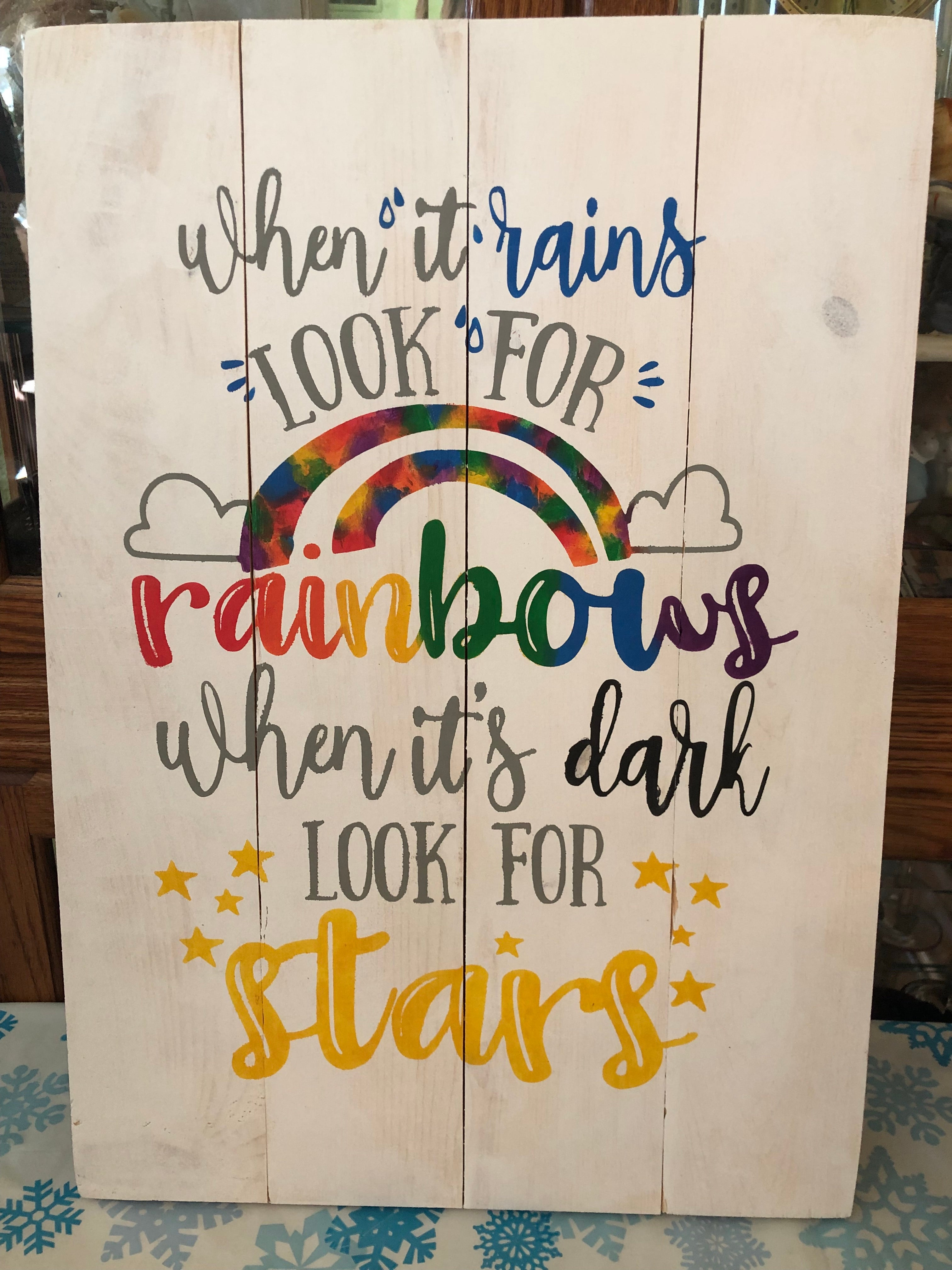 When it rains look for rainbows when its dark look for stars