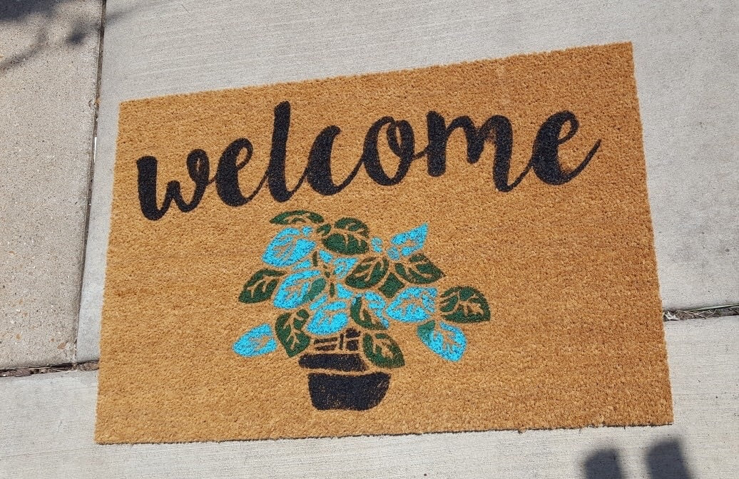 Welcome with plant