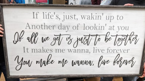 Oversized sign - If life's, just, wakin' up to another day of lookin' at you