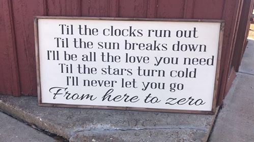 Oversized sign - Til the clock runs out Til the sun breaks down
