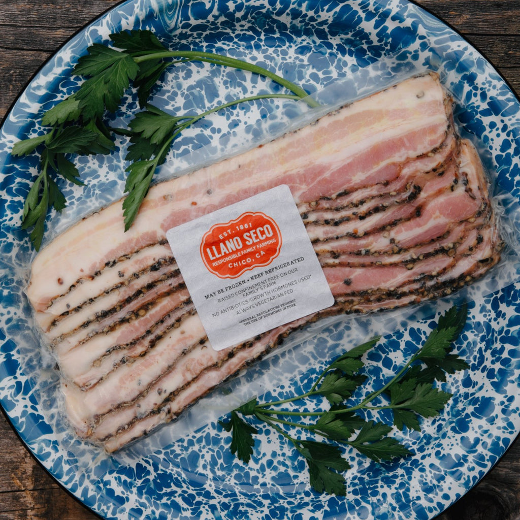 Order Sliced Pepper Bacon | Thick Cut Bacon No Nitrates | Buy Humanely Raised Pork Bacon | Shop California's Historic Rancho Llano Seco