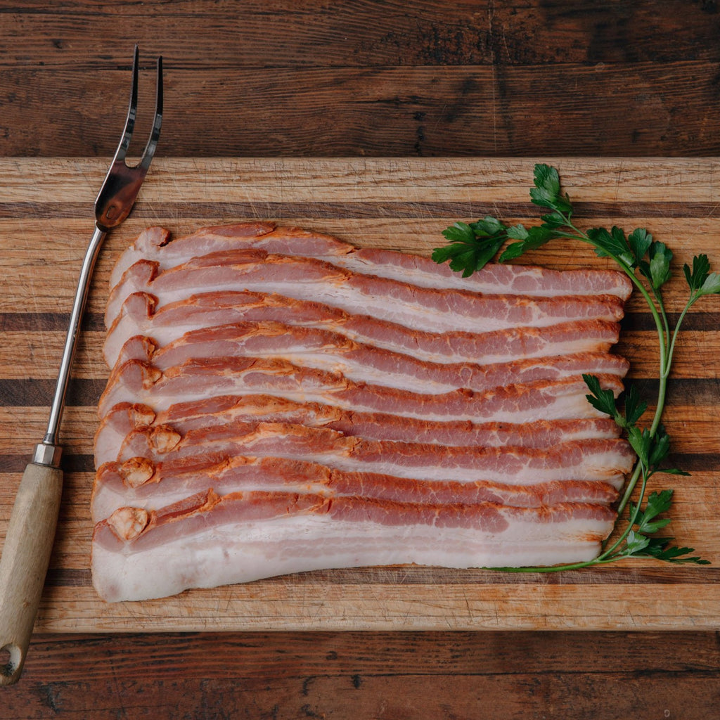 Order California Apple and Alder Wood Smoked Bacon | Shop and Buy Thick Cut and Uncured Bacon | Sustainable pork delivered from California's historic Rancho Llano Seco | No nitrates or nitrites added | Responsible Family Farming